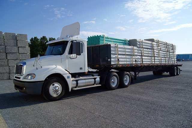 how do tilt tray trucks work?